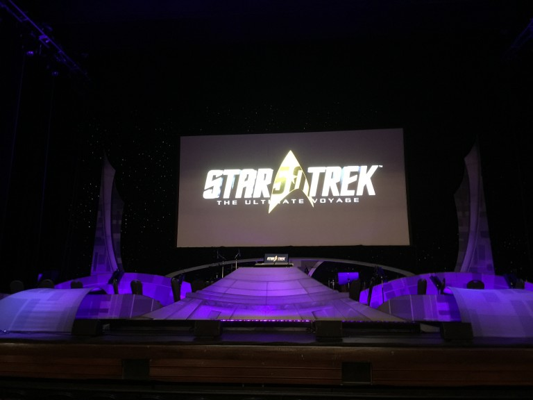 Video montages from all of the Trek series and movies were displayed on the 40-foot screen and time to music being performed by a symphony orchestra.